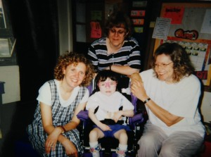 Sophie with Ms. Chris, her Pre-K teacher (to her right) and 2 aides